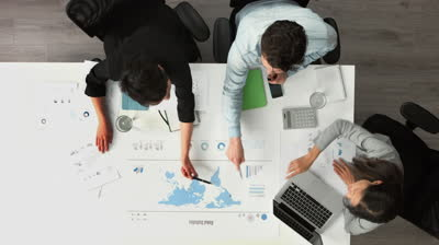stock-footage-business-meeting-arial-view-showing-teamwork-ina-young-diverse-startup